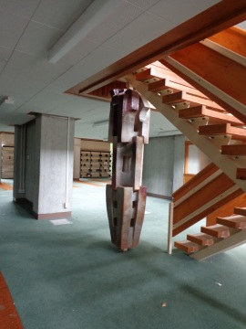 Inside the former library. Stairs leading to a mezzanine floor.